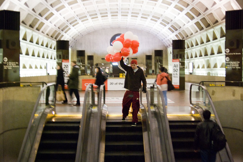 dudes with balloons in the metro station