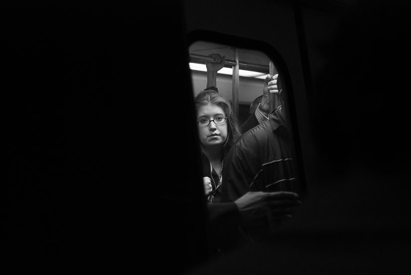 lady on the metro in a small window