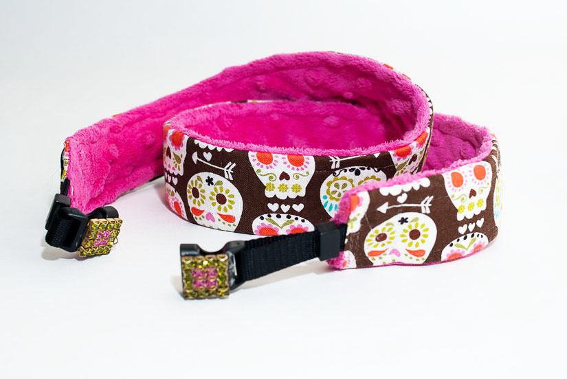 pink camera strap with skulls