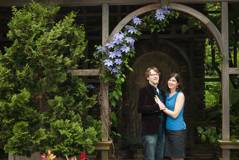 couple under a purple trellis at dumbarton oaks