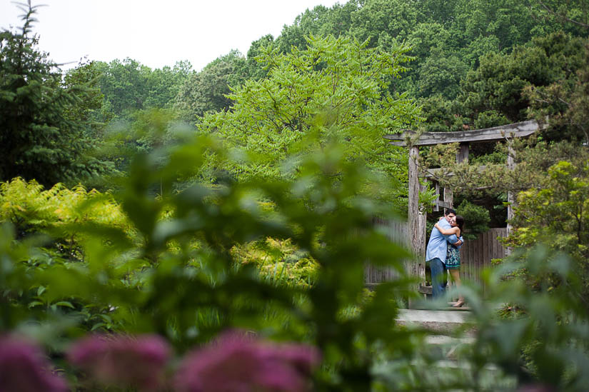 engaged couple at a japanese pagoda in brookside gardens