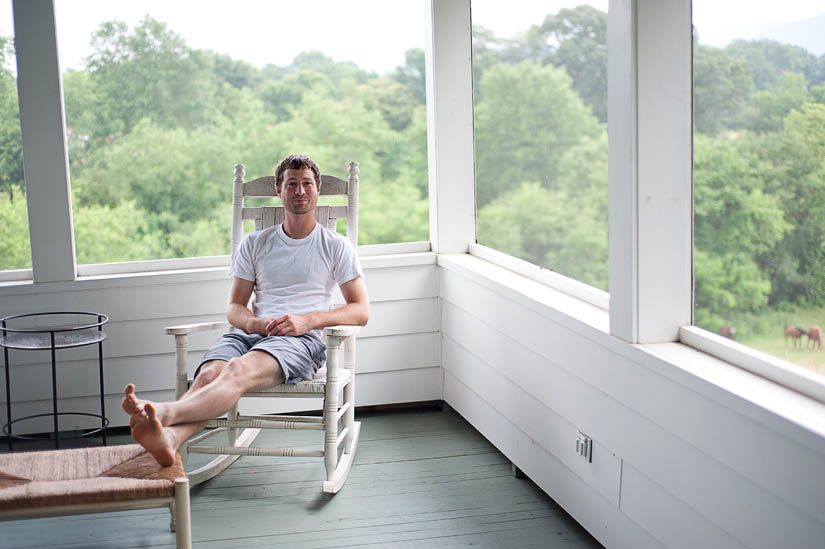 groom sitting on porch in nellysford, va