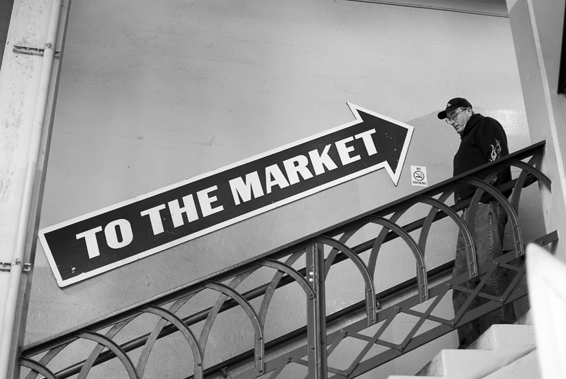 to the market sign with guy in seattle