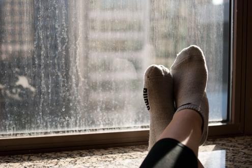 feet on window sill, backlit