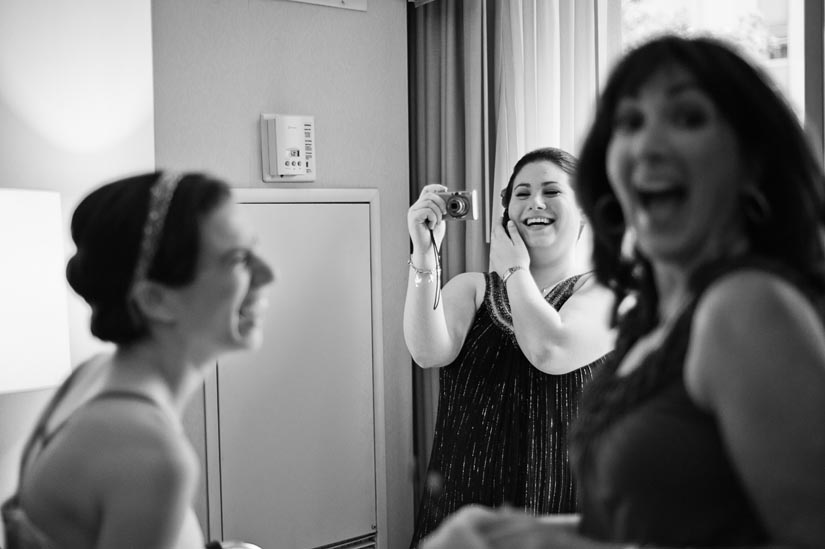 bride and her sister laughing before the wedding