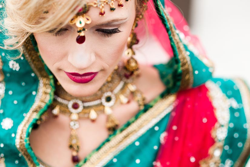 gorgeous red and green sari on bride