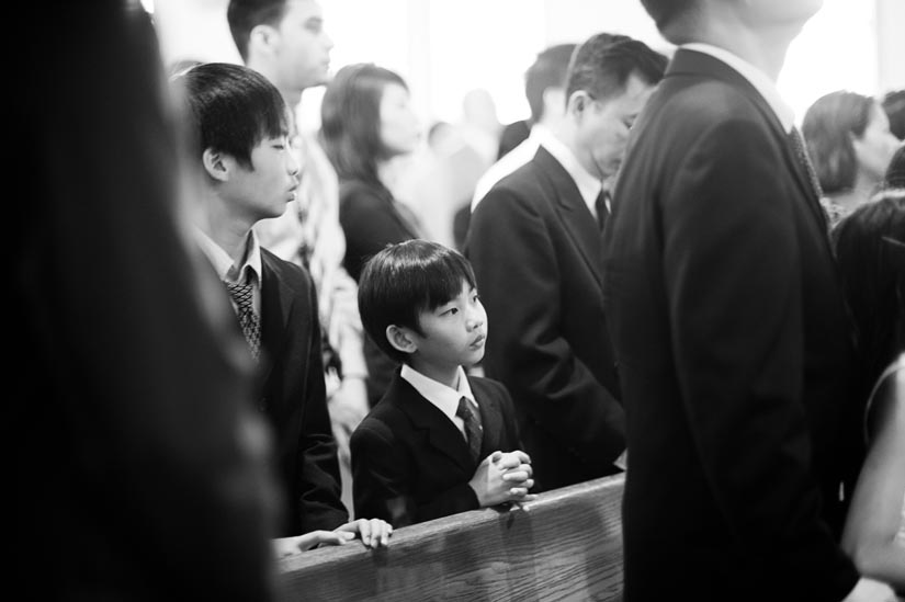 boy praying during church wedding