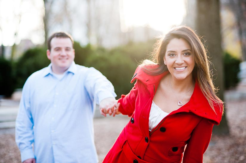 girl in red coat during engagement session