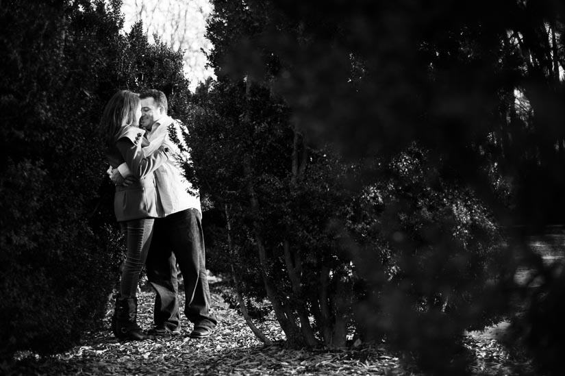 couple hugging in bushes