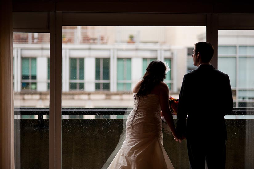 bride and groom watch the snow in washington, dc