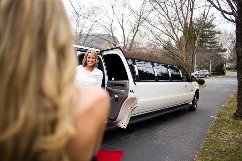 bride in front of a hummer limo