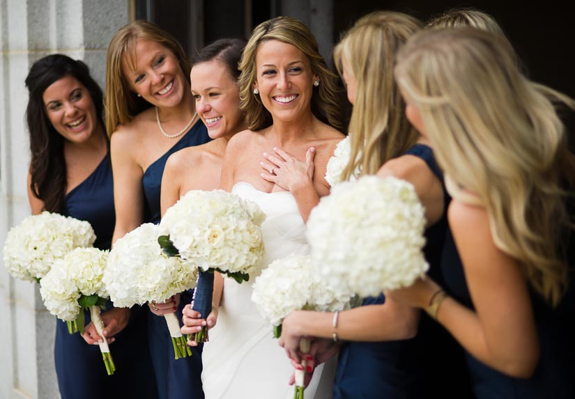 bridal party with white bouquets