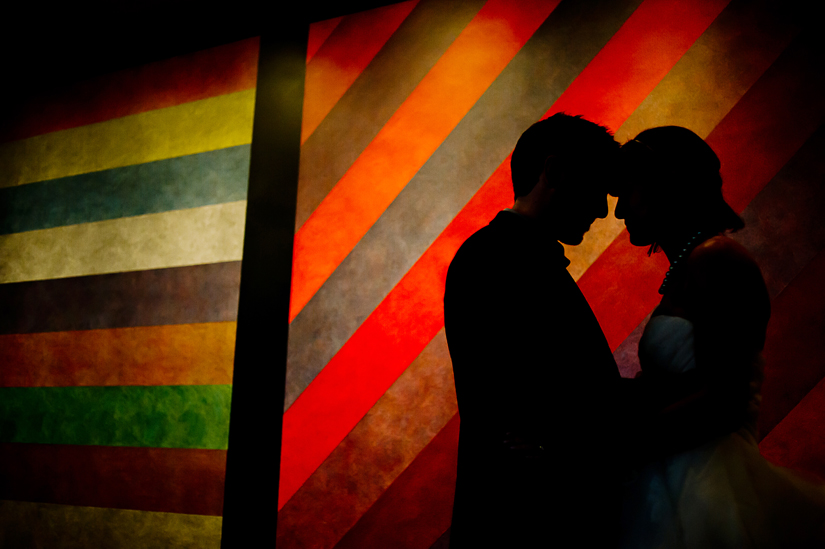 silhouette with modern art and bride and groom