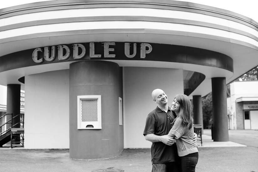 "engagement session with glen echo park ""cuddle up"" sign"