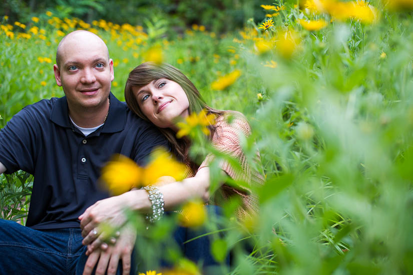 couple in a field of wildflowers at glen echo park