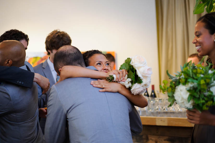 hugging after wedding ceremony at longview gallery