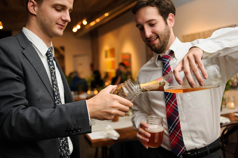 pouring campagne into mason jars at the longview gallery wedding