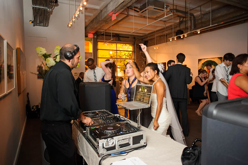bride and maid of honor rockin' with the dj at longview gallery wedding