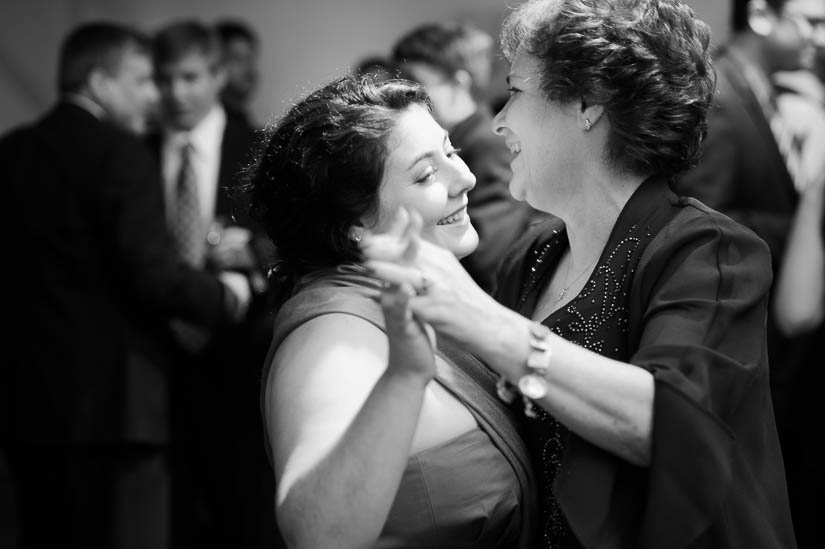groom's sister and mother dancing at longview gallery wedding