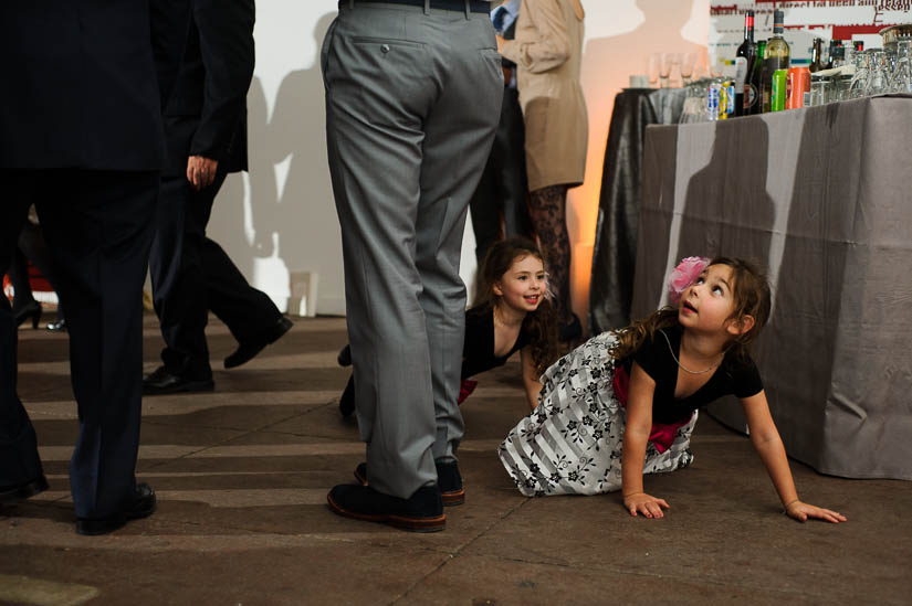 children crawling on the floor at longview gallery wedding