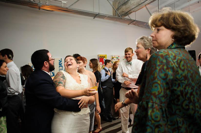 bride and groom laughing at longview gallery wedding