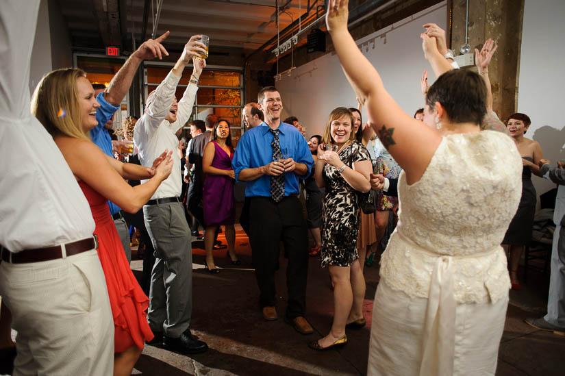 everybody cheering at longview gallery wedding reception
