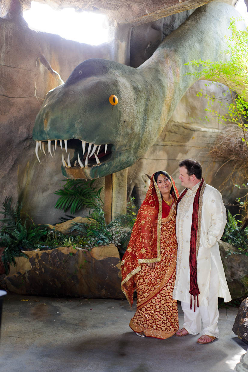 bridal portraits with dinosaur at garden falls