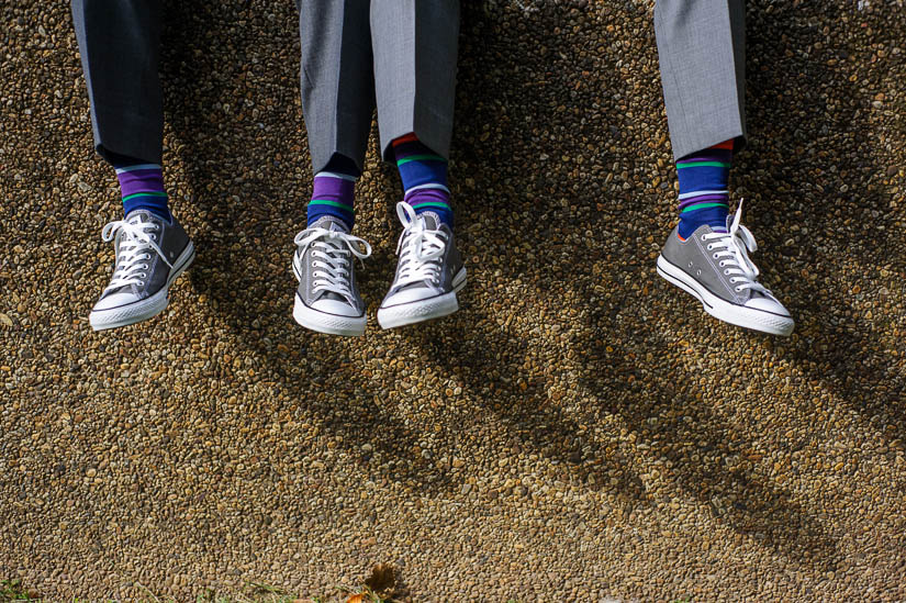gray converse and purple striped socks for the wedding