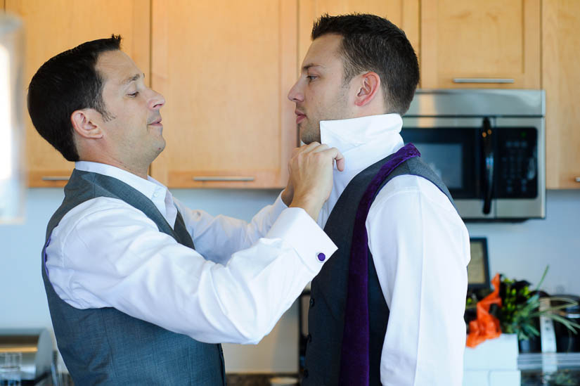 grooms putting on each others' ties