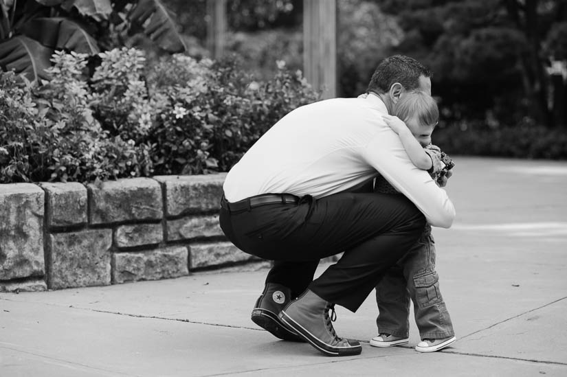 little boy hugging his dad at brookside gardens wedding