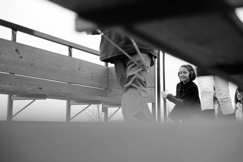 getting on the hay ride during a documentary family portrait session