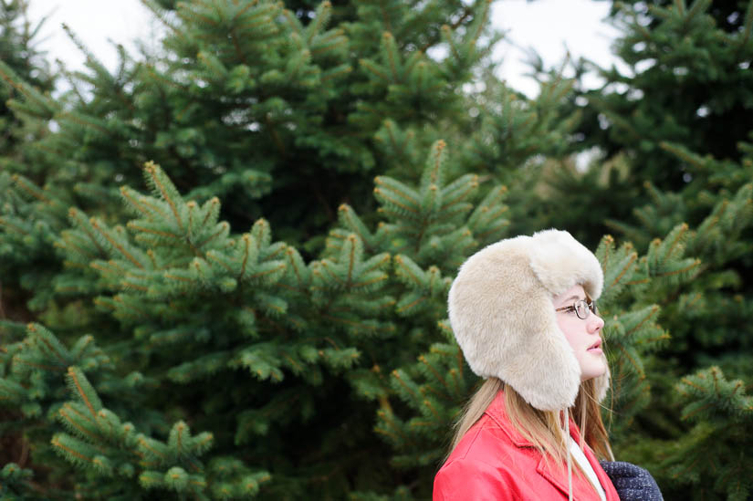 walking through the christmas trees during documentary family shoot