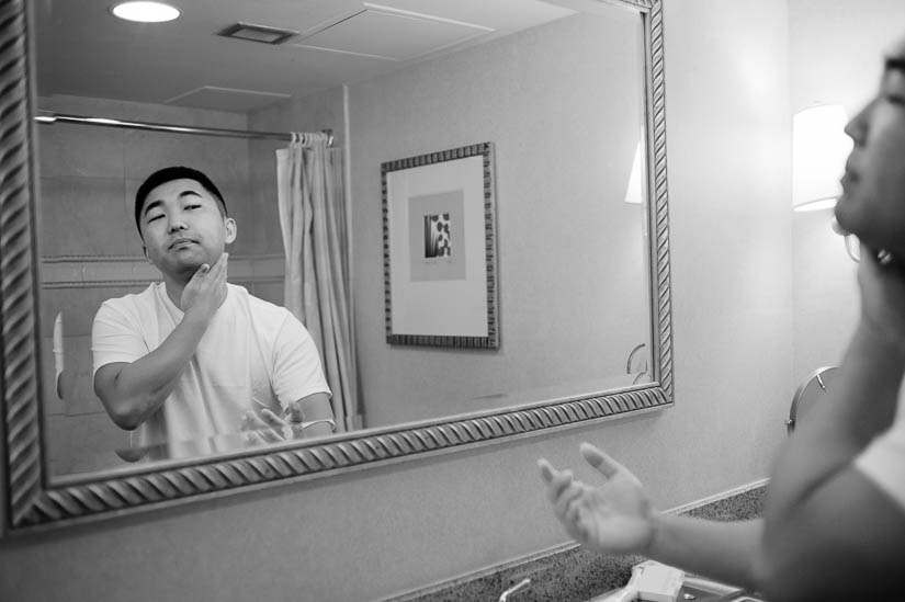 groom shaving before the wedding