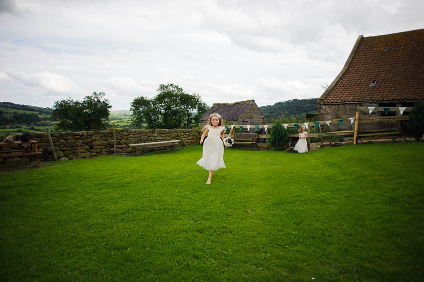 little girl running into the camera at danby castle wedding