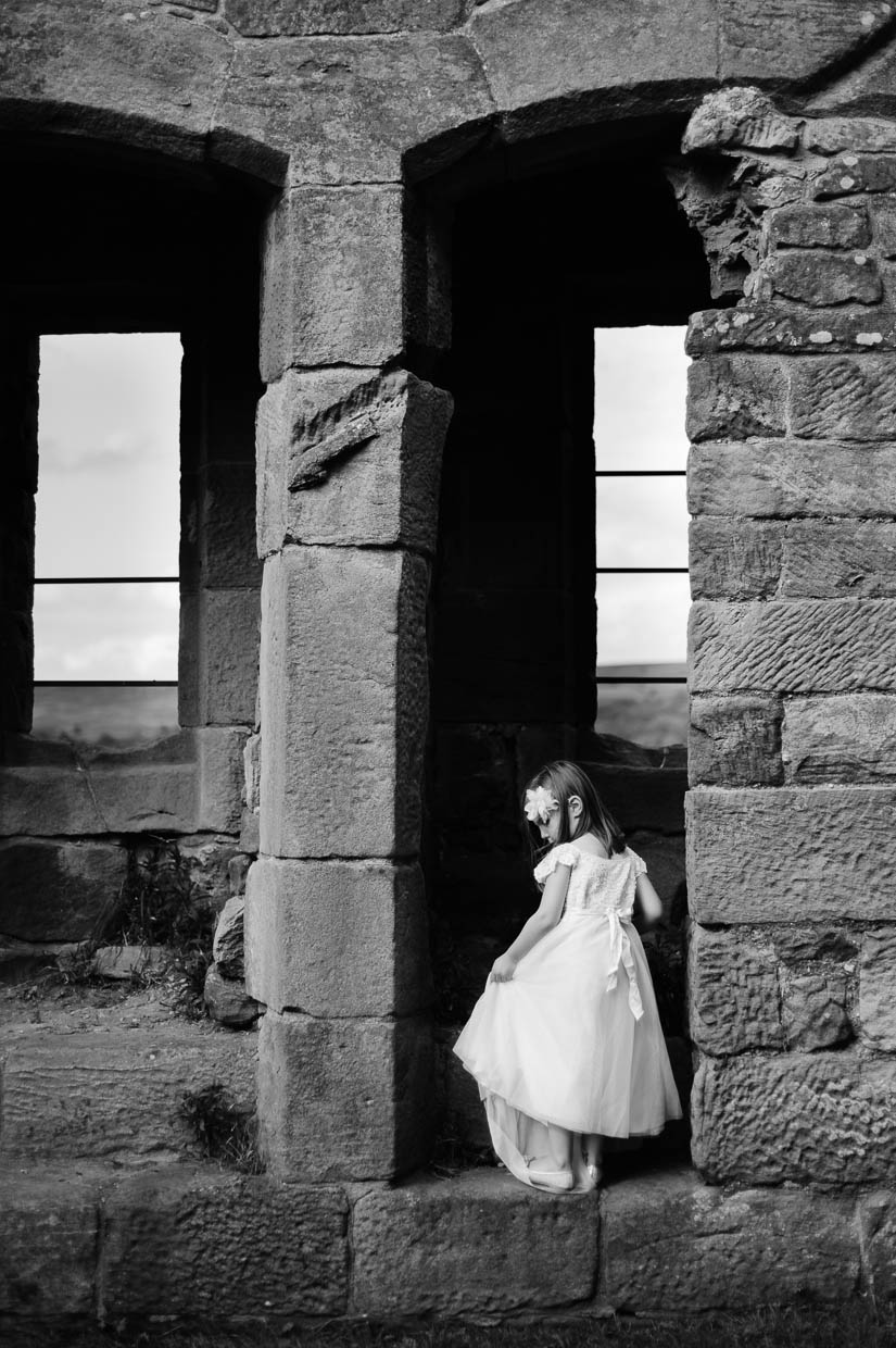 little girl in castle ruins in north yorkshire, england