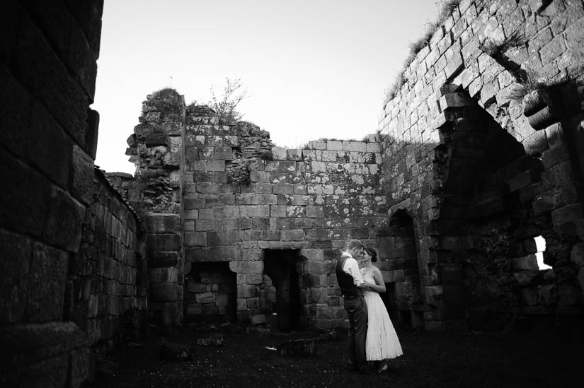 bride and groom portraits in castle ruins in north yorkshire, england