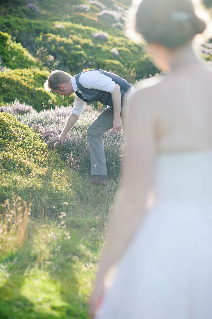 picking heather for his bride
