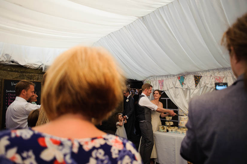 cutting the cake at danby castle wedding