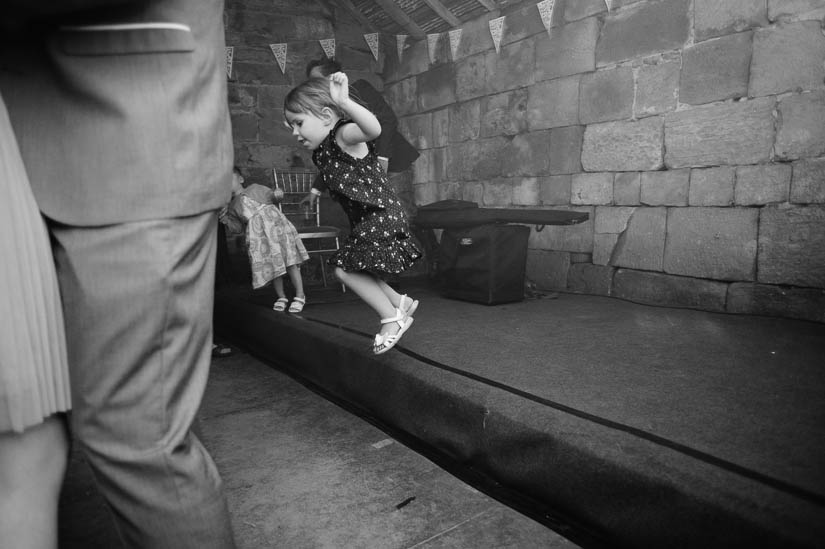 little girl jumping off the stage at danby castle wedding