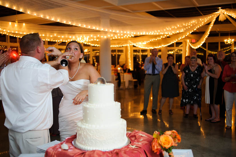 bride and groom sharing champagne at maryland eastern shore wedding