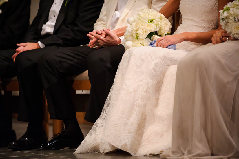 holding hands during the catholic wedding ceremony