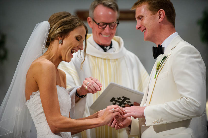 putting on the rings during catholic wedding ceremony at Loyola Blakefield church