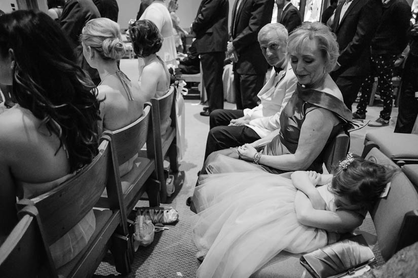 little girl sleeping during wedding ceremony