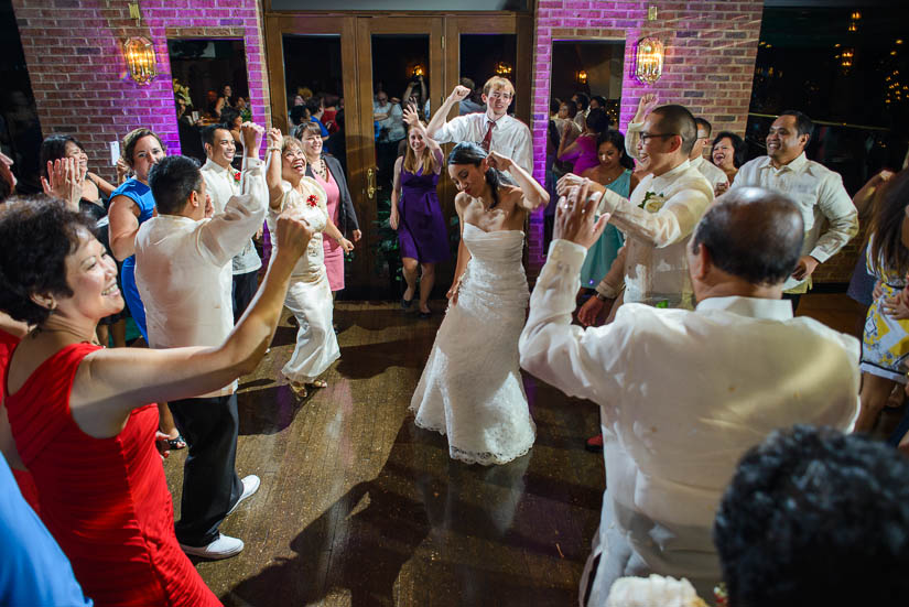 bride and groom dancing at grand atrium wedding